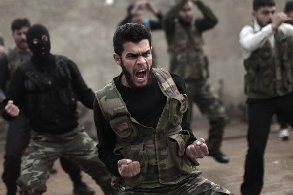 In this Dec. 17, 2012, file photo, Syrian rebels attend a training session in Maaret Ikhwan near Idlib, Syria. (AP Photo/Muhammed Muheisen, File)