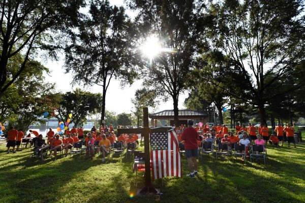 Members of Teen Challenge, gather for a memorial service at River Park Saturday, July 18, 2015, in Chattanooga, Tenn., for the victims of the Tennessee shootings. (AP Photo/Mark Zaleski)