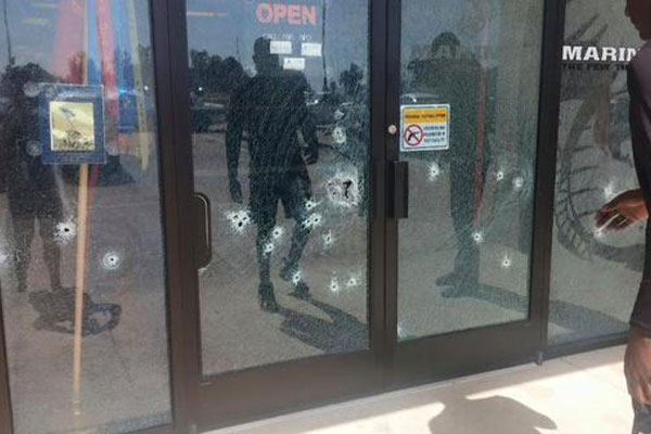 Bullet holes in the entrance to the Chattanooga military recruiting center (Photo: April Grimmett via Twitter)