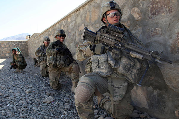 U.S. Army soldiers with Charlie Troop, 3rd Squadron, 89th Cavalry, 4th Infantry Brigade Combat Team, 10th Mountain Division wait for the order to move against enemy positions in Charkh, Logar province, Afghanistan, on Nov. 13, 2010. (Sgt. Sean P. Casey)