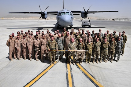 The men and women of the 702nd Expeditionary Airlift Squadron gather for a group photo before the start of their deactivation ceremony at Kandahar Airfield, Afghanistan, on June 18, 2012.