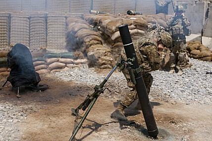 Army mortarmen fire a new Precision Guided Round from a 120mm motar in Afghanistan