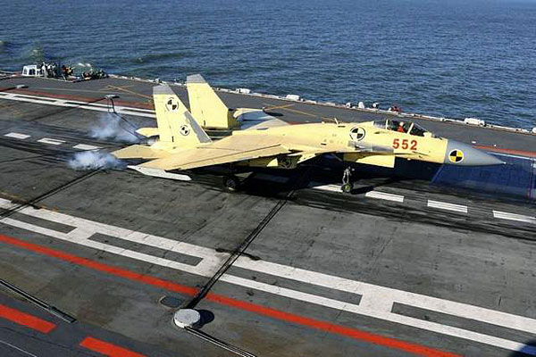 In this undated photo released by China's Xinhua News Agency, a carrier-borne J-15 fighter jet lands on China's first aircraft carrier, the Liaoning. /AP