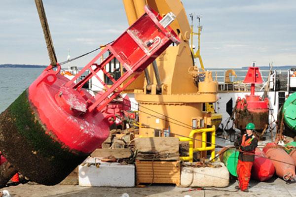 Coast Guard Cutter Bristol Bay crew using crane 600x400