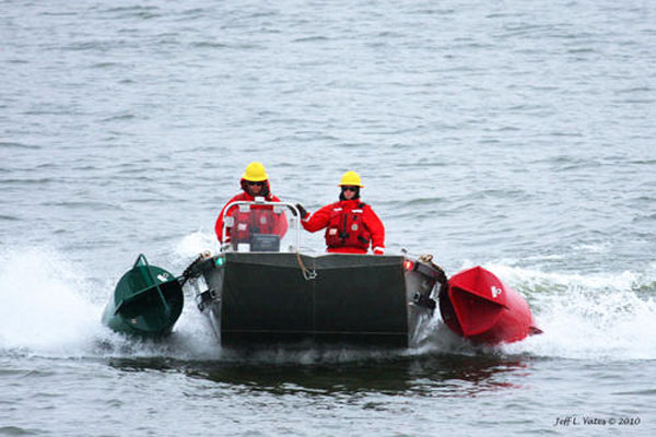 Coast Guard crew on flat-bottom boat 600x400