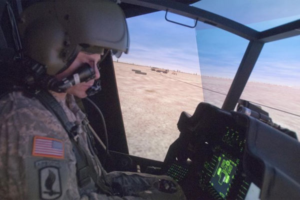 Soldier in AH-64 Apache simulator 600x400