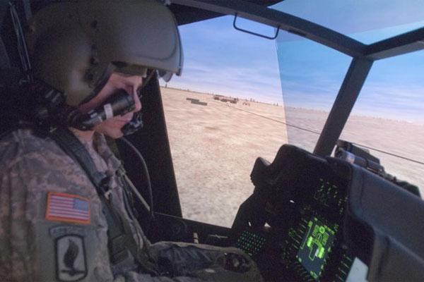 Soldier in AH-64 Apache simulator 600x400