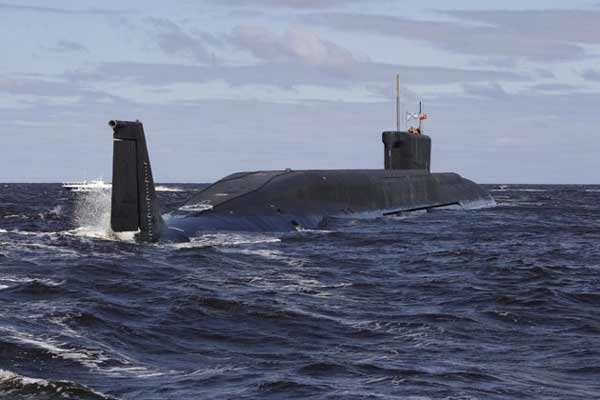 In this Thursday, July 2, 2009 file photo a new Russian nuclear submarine, Yuri Dolgoruky, is seen during sea trials near Arkhangelsk, Russia. The submarine was commissioned by the Russian Navy on Thursday, Jan. 10, 2013. (AP Photo/Alexander Zemlian
