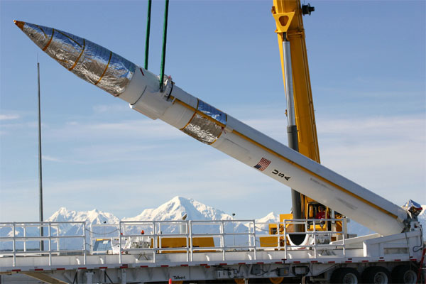 A ground-based missile interceptor is lowered into its missile silo during a recent emplacement at the Missile Defense Complex at Fort Greely, Alaska.