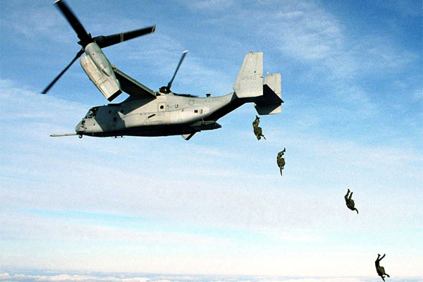 U.S. Marine Corps parachutists free fall from an MV-22 Osprey at 10,000 feet above the drop zone at Fort A.P. Hill, Va. on Jan. 17, 2000.