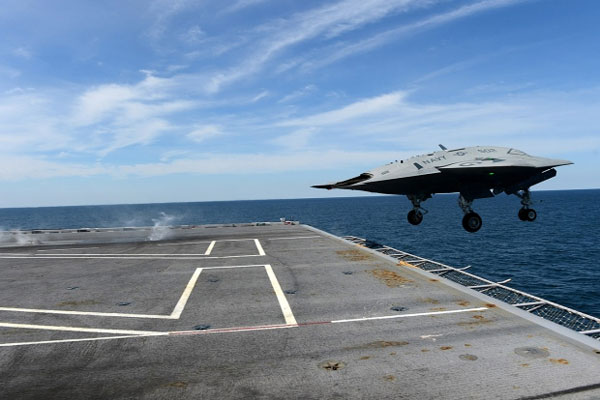 An X-47B Unmanned Combat Air System demonstrator launches from the aircraft carrier USS George H.W. Bush on May 14, 2013. (US Navy)