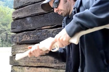 "A man who would identify himself only as ""Matthew"" fires a homemade rifle he calls ""The Grizzly 2.0"" in a YouTube video. (YouTube)"