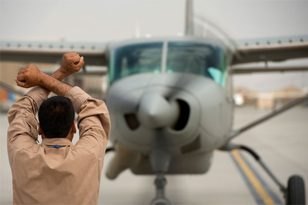 Afghan directing prop plane 600x400