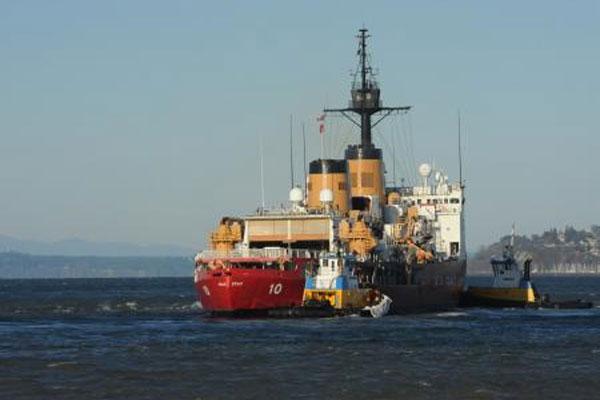 Two tugboats escort Coast Guard Cutter Polar Star 600x400