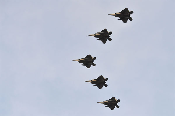 Five F-22 Raptors fly in formation