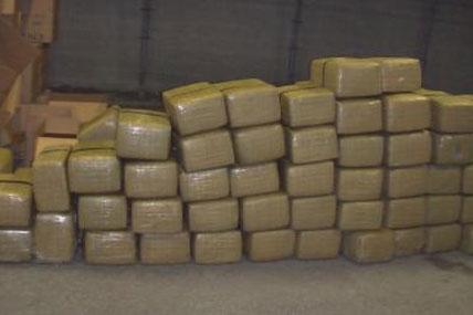 Bales of marijuana seized from a panga boat