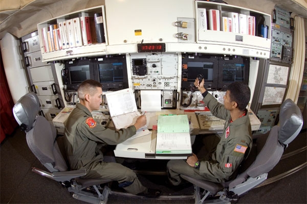 FILE PHOTO - In the underground launch control center at Minot Air Force Base's Missile Alert Facility B-1. The missile combat crew are on duty for 24 hours, able to monitor and launch Minuteman III missiles if directed. (U.S. Air Force photo/Master Sgt.