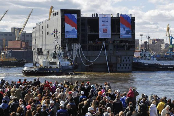 The stern of Sevastopol, a Mistral class, amphibious assault ship is launched at St.Petersburg naval shipyard on Wednesday, April 30, 2014. (AP Photo/Dmitry Lovetsky)