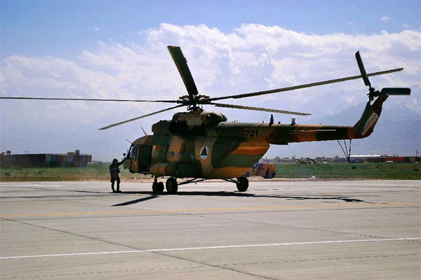 FILE - In this Monday, May 13, 2013 file photo, an Mi-17 helicopter used by the Afghan Air Force sits on Bagram Air Field in Afghanistan. (AP Photo/Kristin M. Hall, File)