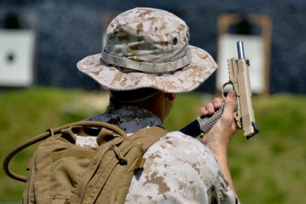 MARSOC operator changes magazines into a M45A1 close quarter battle pistol. (Marine Corps photo)