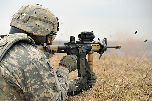 A U.S. Army soldier fires an M4. Army photo
