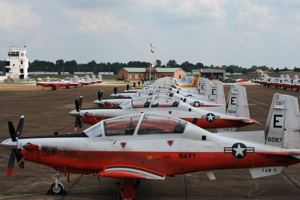 T-6B Texan II training aircraft assigned to Training Wing 5 from Pensacola, Fl., are staged on the tarmac at Millington Regional Jetport after being evacuated in hurricane preparation. (U.S. Navy/Mass Communication Specialist 3rd Class Ty C. Connors)