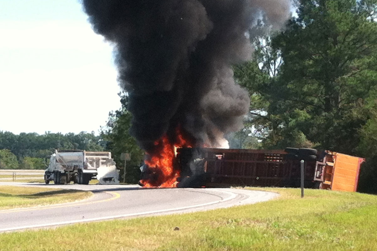 coast guardsmen rescue truck driver from burning vehicle. Black Bedroom Furniture Sets. Home Design Ideas