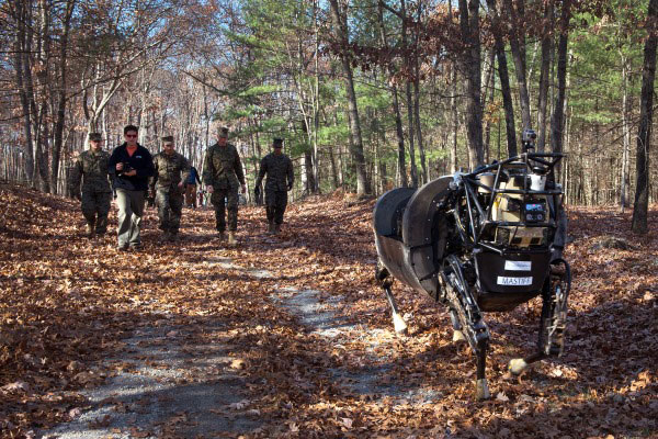 Marines with 1st Battalion, 5th Marine Regiment, test the capabilities of the Legged Squad Support System (LS3), aboard Fort Devens, Mass., Nov. 5, 2013. (U.S. Marine Corps photo by Sgt. Michael Walters/Released)
