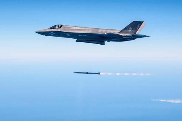 F-35 test pilot Marine Maj. Douglas 'Rosie' Rosenstock, live fires an AIM-120 Advanced Medium Range Air-to-Air Missile from an F-35B above the Point Mugu Sea Test Range, California. (F-35 Joint Program Office)