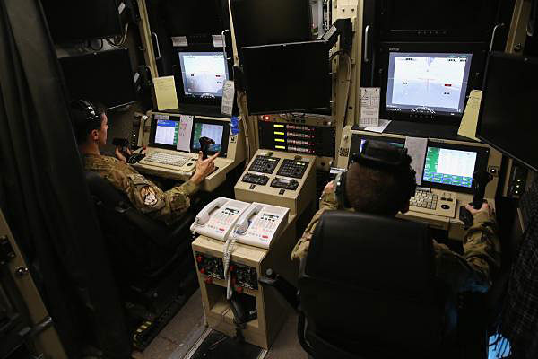 RPA (Drone) pilots at control center.