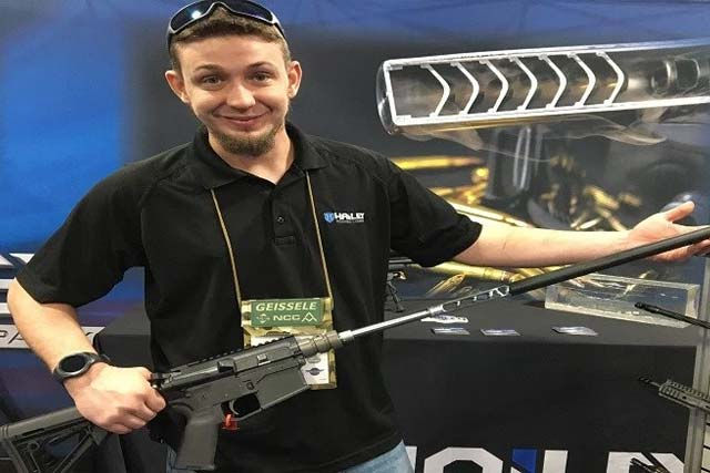 CJ Hunter, machinist for Hailey Ordnance, shows the new AeGIS suppressor system at SHOT Show. Photo by Hope Hodge Seck