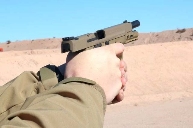 Smith & Wesson's new M&P M2.0 pistol on the range for the first time at SHOT Show 2017. (Photo: Matthew Cox, Military.com)