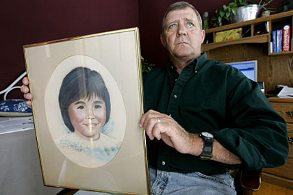 Jerry Ensminger holds a portrait of his daughter, Janey. Ensminger has worked since 1997 to raise awareness about toxic wells at Camp Lejeune and get compensation for those adversely affected.