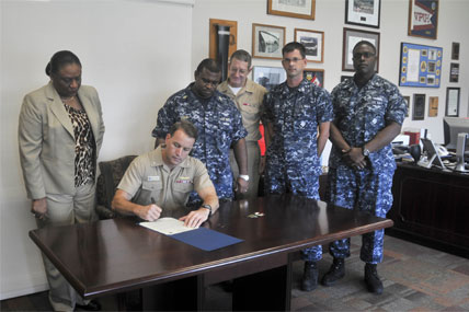 Admiral signing document 428x285