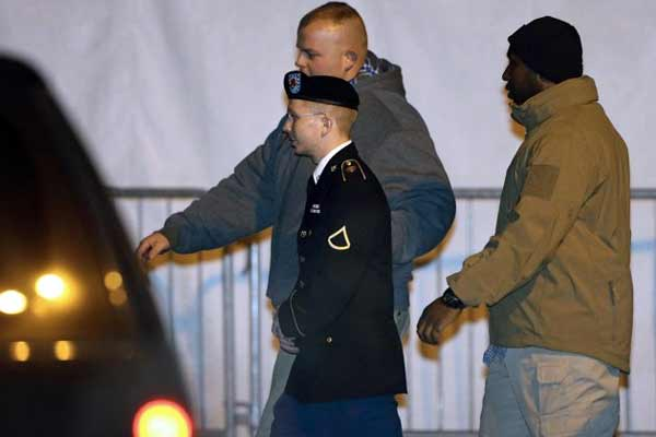 Army Pfc. Bradley Manning, center, is escorted to a security vehicle outside of a courthouse in Fort Meade, Md., Tuesday, Nov. 27, 2012, after attending a pretrial hearing. Manning is charged with aiding the enemy.