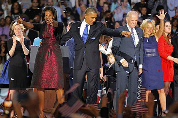 President Barack Obama , joined by his wife Michelle, Vice President Joe Biden and his spouse Jill acknowledge applause after Obama delivered his victory speech to supporters gathered in Chicago early Wednesday, Nov. 7, 2012.