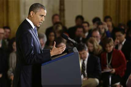 President Barack Obama gestures as he answers a question during a news conference in the East Room of the White House in Washington, Wednesday, Nov. 14, 2012.