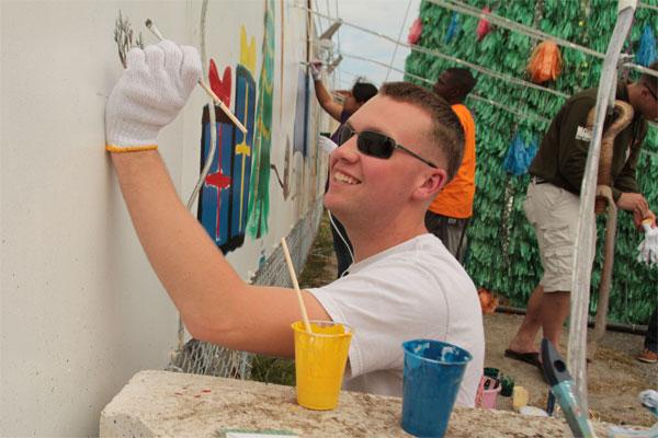 Lance Cpl Austin Scott paints mural 600x400