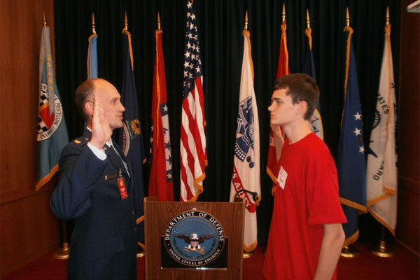 Maj Christopher Gering swears in son 600x400