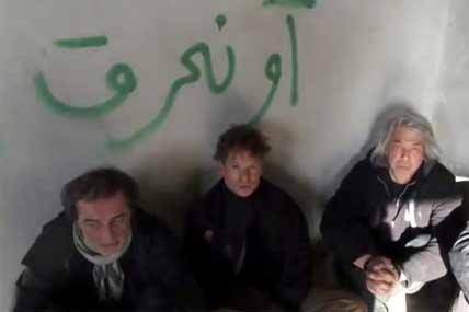 This image taken from undated amateur video posted on the Internet shows NBC chief foreign correspondent Richard Engel, center, with NBC Turkey reporter Aziz Akyavas, left, and NBC photographer John