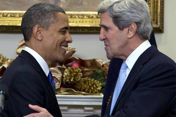 President Barack Obama looks to Sen. John Kerry, D-Mass., after announcing his nomination as the next secretary of state in the Roosevelt Room of the White House, Friday, Dec. 21, 2012.