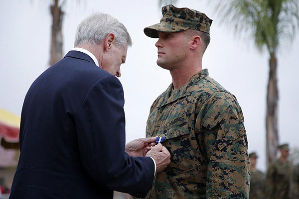 Marine Sgt. William Soutra Jr., right, receives the Navy Cross from Secretary of the Navy Ray Mabus during a ceremony held at Camp Pendleton, Calif., on Monday, Dec. 3, 2012.