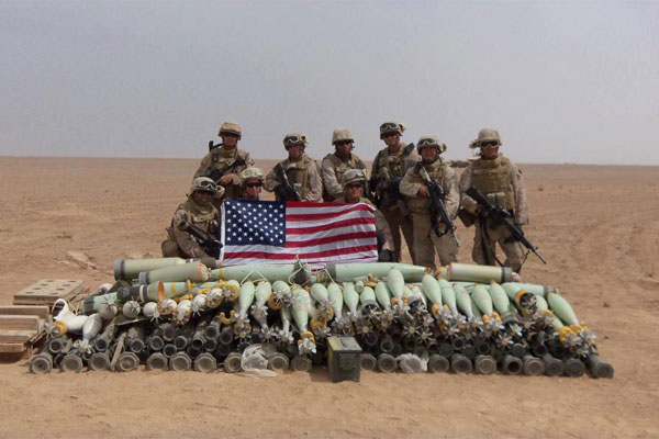 Marines in front of a munitions cache 600x400