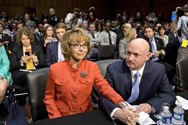 Former Arizona Rep. Gabrielle Giffords with her husband, Mark Kelly, right, on Capitol Hill in Washington, Wednesday, Jan. 30, 2013, prior to speaking before the Senate Judiciary Committee hearing on what lawmakers should do to curb gun violence.