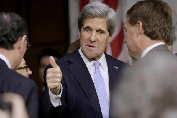 John Kerry, D-Mass., President Barack Obama's nominee to become secretary of state, gives a 'thumbs-up as he arrives on Capitol Hill in Washington, Thursday, Jan. 24, 2013, to testify before his confirmation hearing.