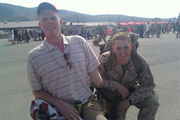 Lance Cpl. Matthew J. Rodgers with friend 600x400