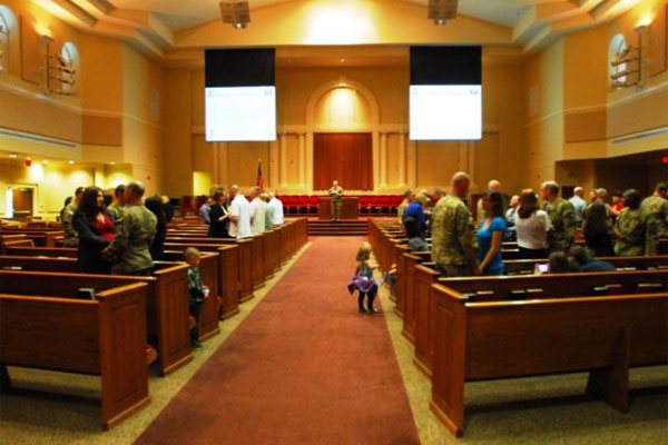 Couples renewing vows in chapel 600x400