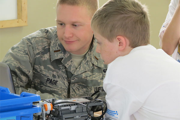 Air Force Second Lt. William Page mentors student 600x400