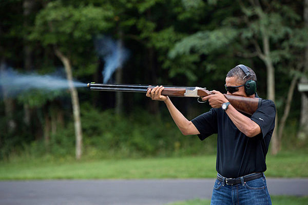 In this photo released by the White House, President Barack Obama shoots clay targets on the range at Camp David, Md.