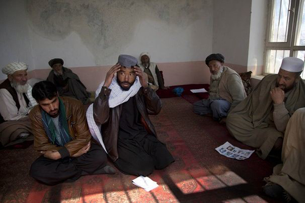 An Afghan man speaks about how he and his two brothers were picked up several months ago by U.S. Special Forces. He still does not know his brothers' whereabouts. The Maidan Shahr villagers want U.S. troops to leave the region.(AP Photo/Anja Niedringhaus)